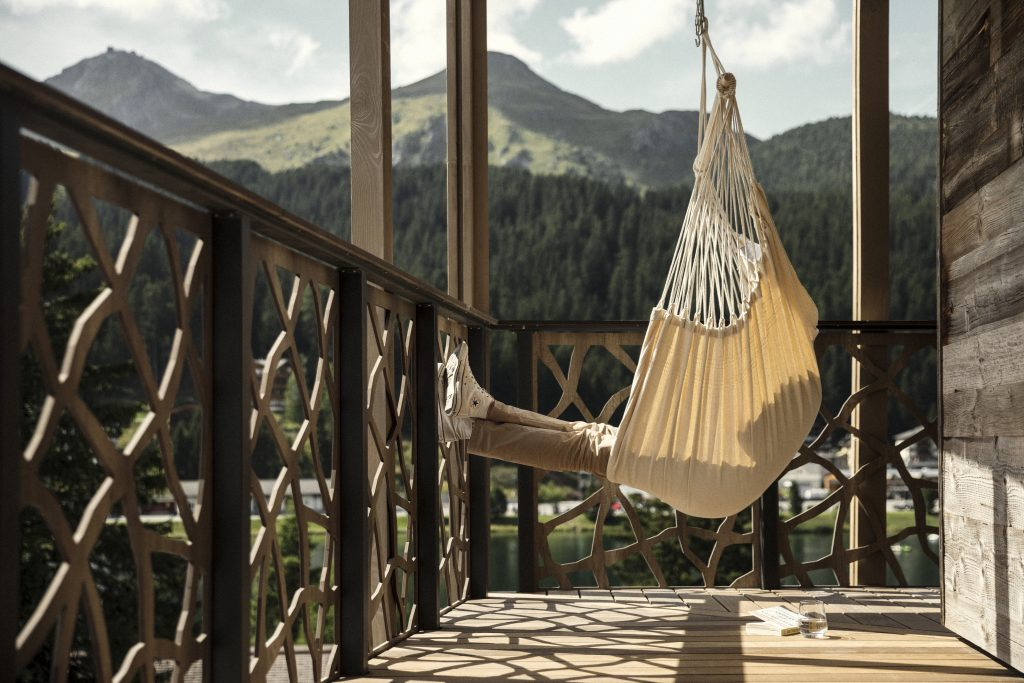 Person sitting in a hammock at Valsana Hotel as advertised by Kiwano Hotels