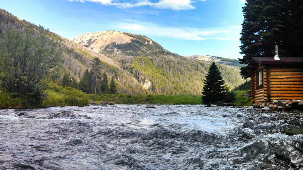 Water flowing down the creek at Flat Creek Ranch in Wyoming as advertised by Kiwano Hotels