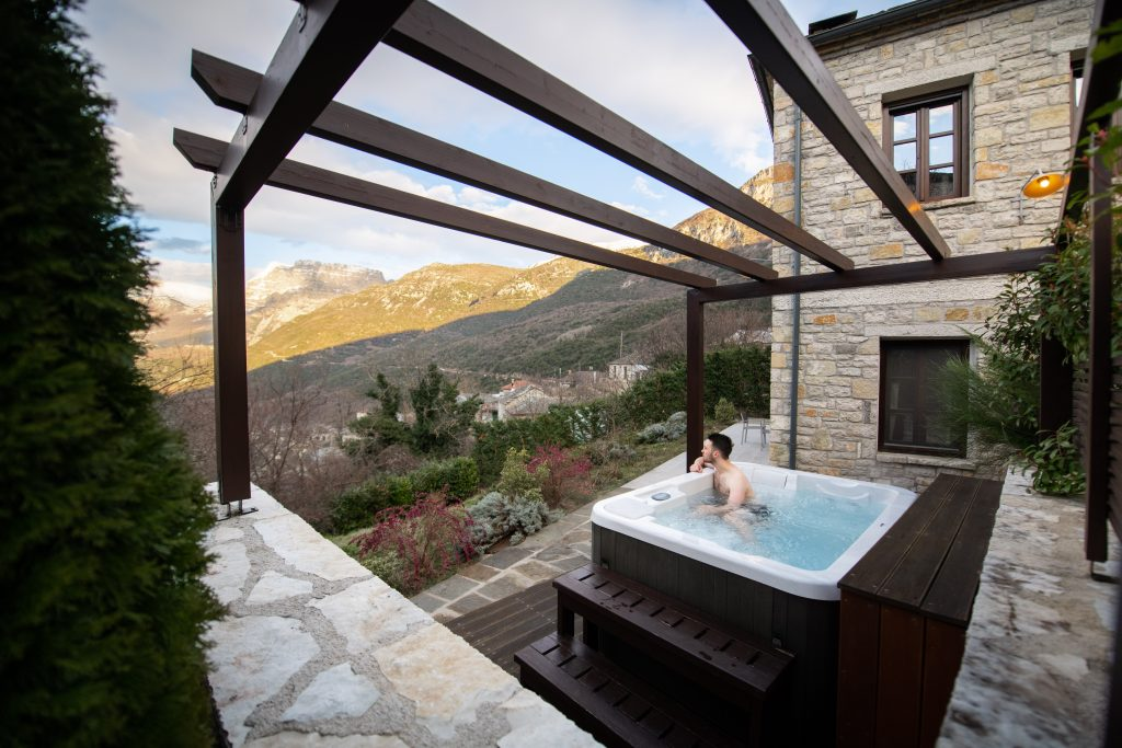 Outdoor Jacuzzi at Aristi Mountain Resort & Villas in Greece as advertised by Kiwano Hotels