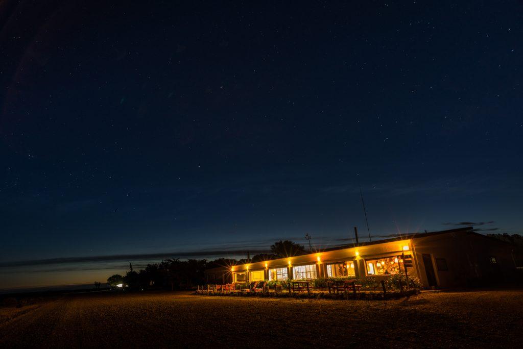 View of Bahia Bustamante Lodge at nighttime